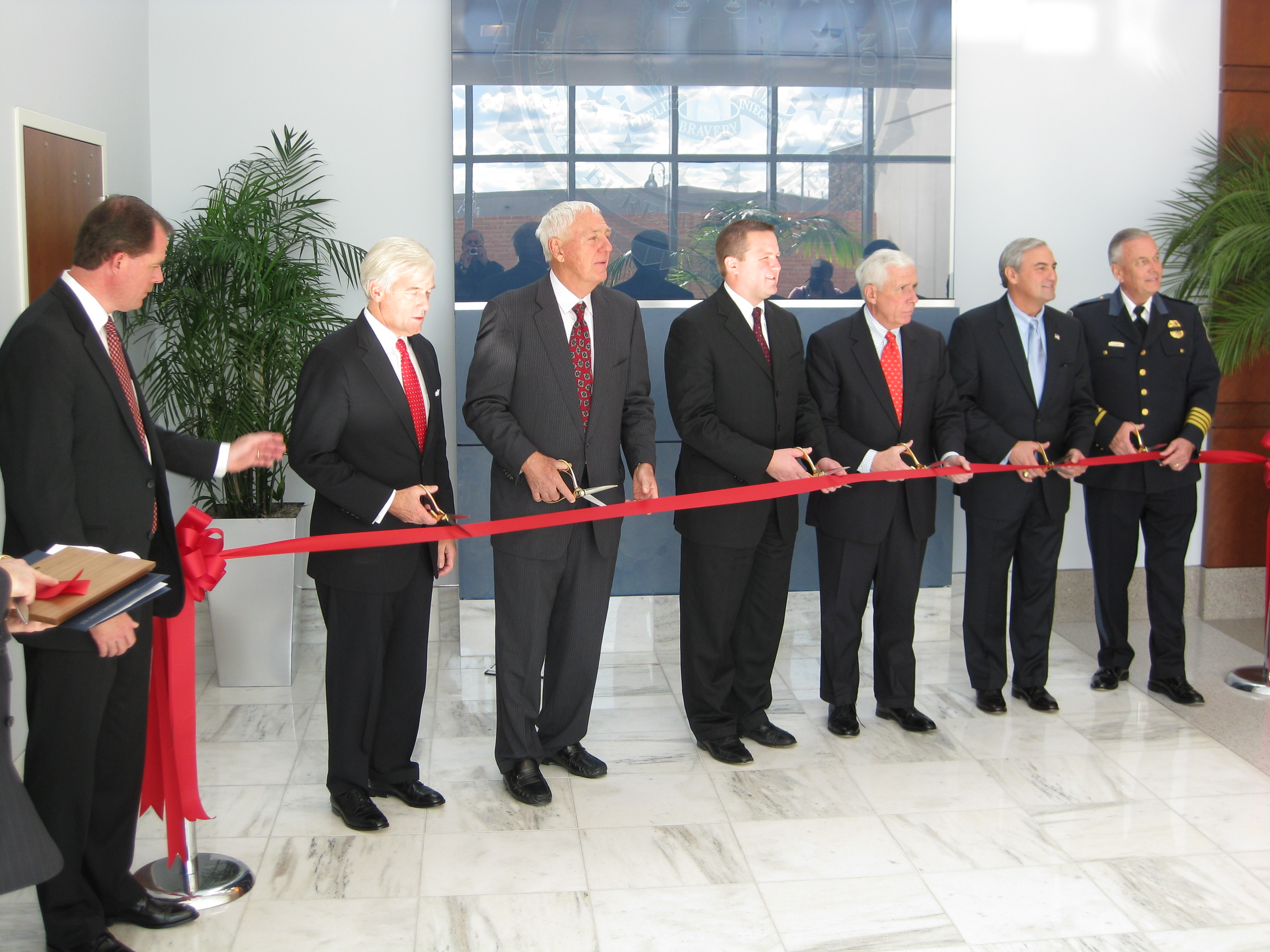 Several prominent officials cut the ribbon include Rep. Frank Wolf and Joseph Persichini Jr., head of the Washington field office