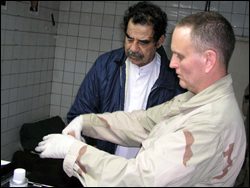 FBI Agent fingerprints Saddam Hussein/fbi photo