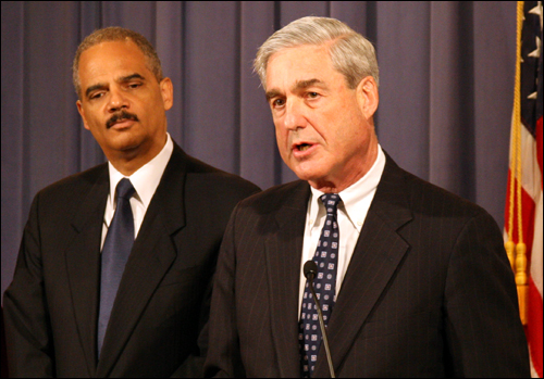 Atty. Gen. Holder (left) and FBI Director Mueller announce results/fbi photo