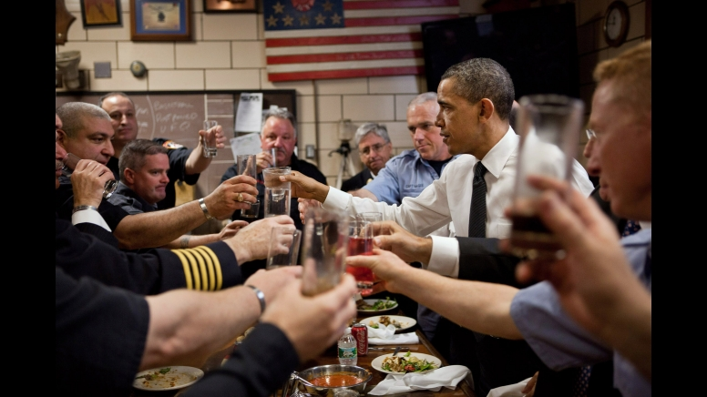 Pres. Obama toasts firefighters at the station Thursday/white house photo