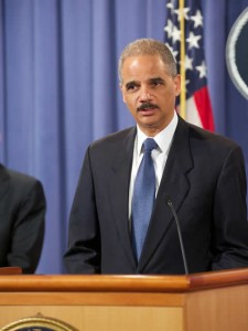 [eric-holder-standing-doj-photo-225x300]