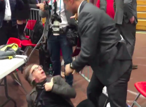 A Time photographer is slammed to the ground by a Secret Service agent at a Donald Trump rally.