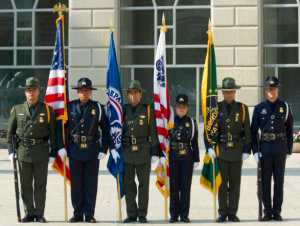 Trademark green uniforms worn by Border Patrol agents.