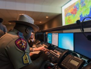 "At the Super Bowl command post, a Texas Highway Patrol officer takes part in a ""rehearsal of concept"" exercise several weeks prior to the command post going operational."