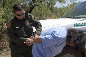 Border Patrol agent makes an arrest. Photo via Border Patrol.