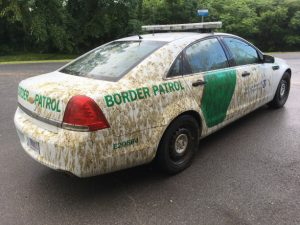 Border Patrol car covered in liquid manure. Photo via CBP.