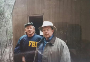 Agents John Steiner and Jerry Webb at Ted's front door.